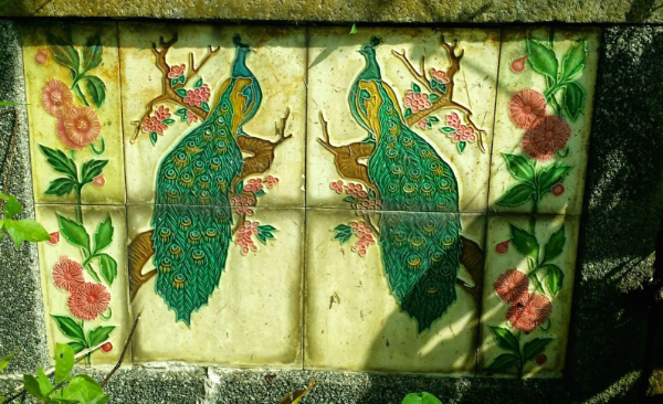 Tiles featuring a pair of peacocks on my great-grandmother's grave at Bukit Brown Cemetery.