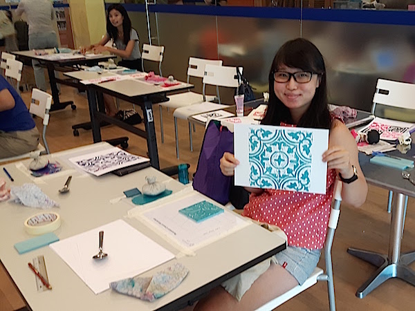 Block printing on paper - also called linocut.