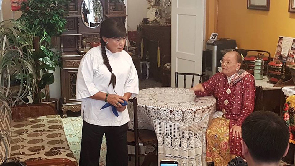 Veteran female impersonator GT Lye as Bibik Bisu with old family maid 'majie' Ah Nui.