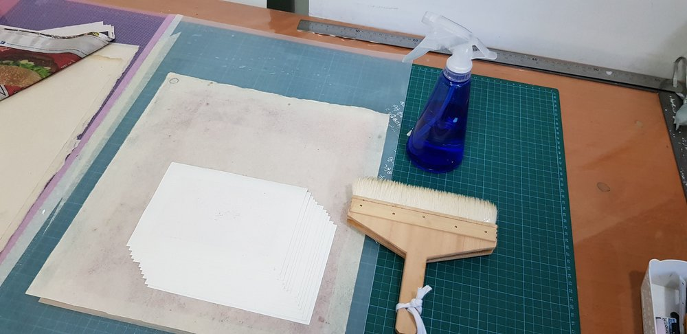 Dampening each hand-cut sheet of paper is one of the easiest jobs!