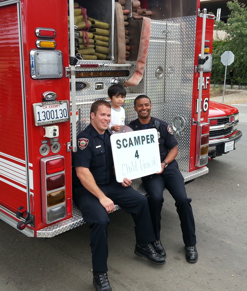 What a treat it was for Haruto to have his photo taken with the firefighters holding the sign for why we scamper.