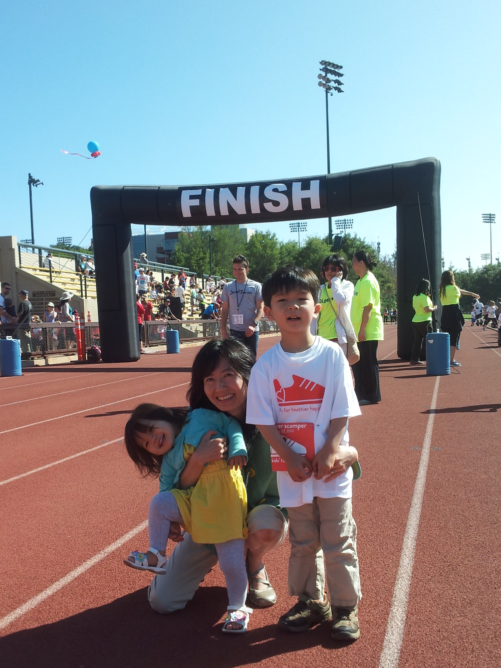 At the finish line of the Kids' Fun Run at Summer Scamper 2014, Haruto's second time in the Kids' Fun Run and our first time fundraising for the Bereavement and Family Guidance Program.