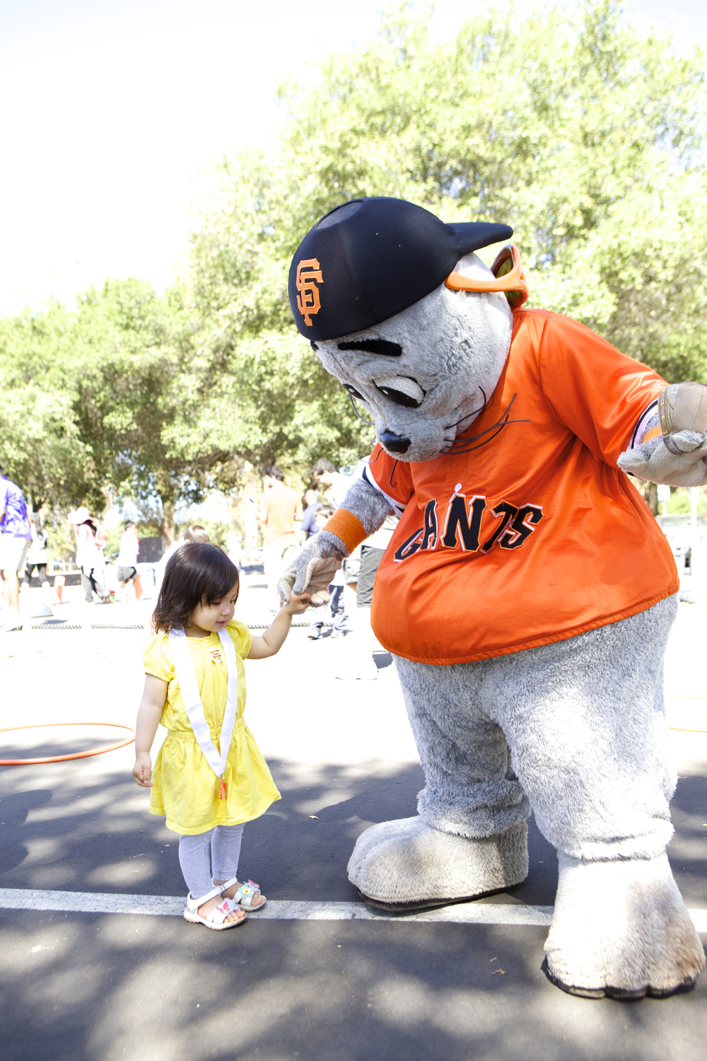At the Family Festival, Haruka Lucile with SF Giants mascot, Lou Seal - a meaningful photo for us because Haruka Lucile is named in honor of Lucile Packard.  We love the two Luciles!