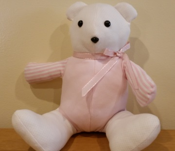 Thanks to the Memory Bear Project offered by the Bereavement and Family Guidance Program, we had two teddy bears made from Harumi's baby clothes.