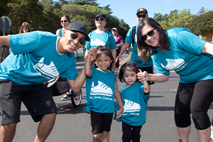"""Summer Scamper has become a family tradition. We started off with three of us. I Scamper-ed after we had Aria, and then again when I was pregnant with Mavis. The following year baby Mavis joined the team. Now our team keeps growing!"" - Cecil with husband Randy and their two kids. Read their story on our blog."