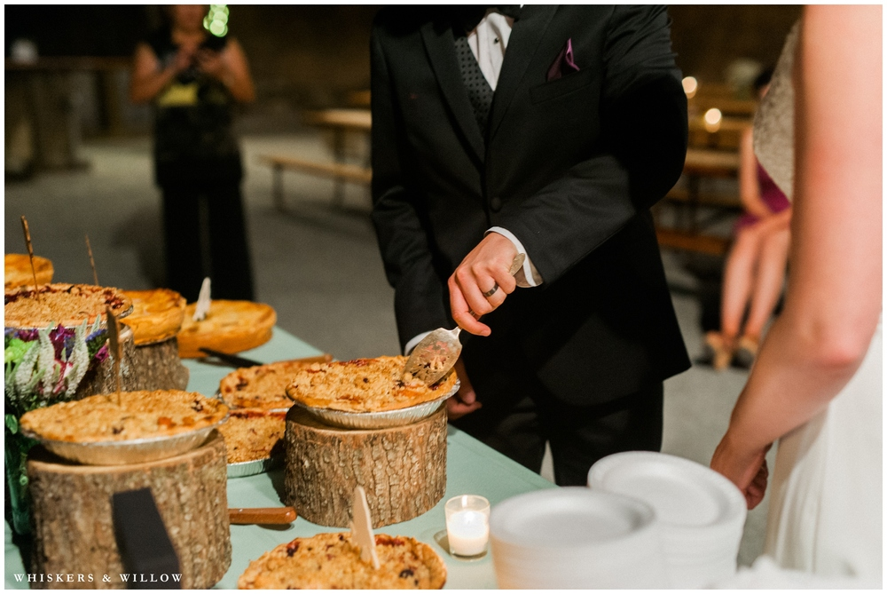 Saratoga Springs Wedding - Forest woodland wedding - picnic table reception - rustic pie cutting - Whiskers and Willow Photography