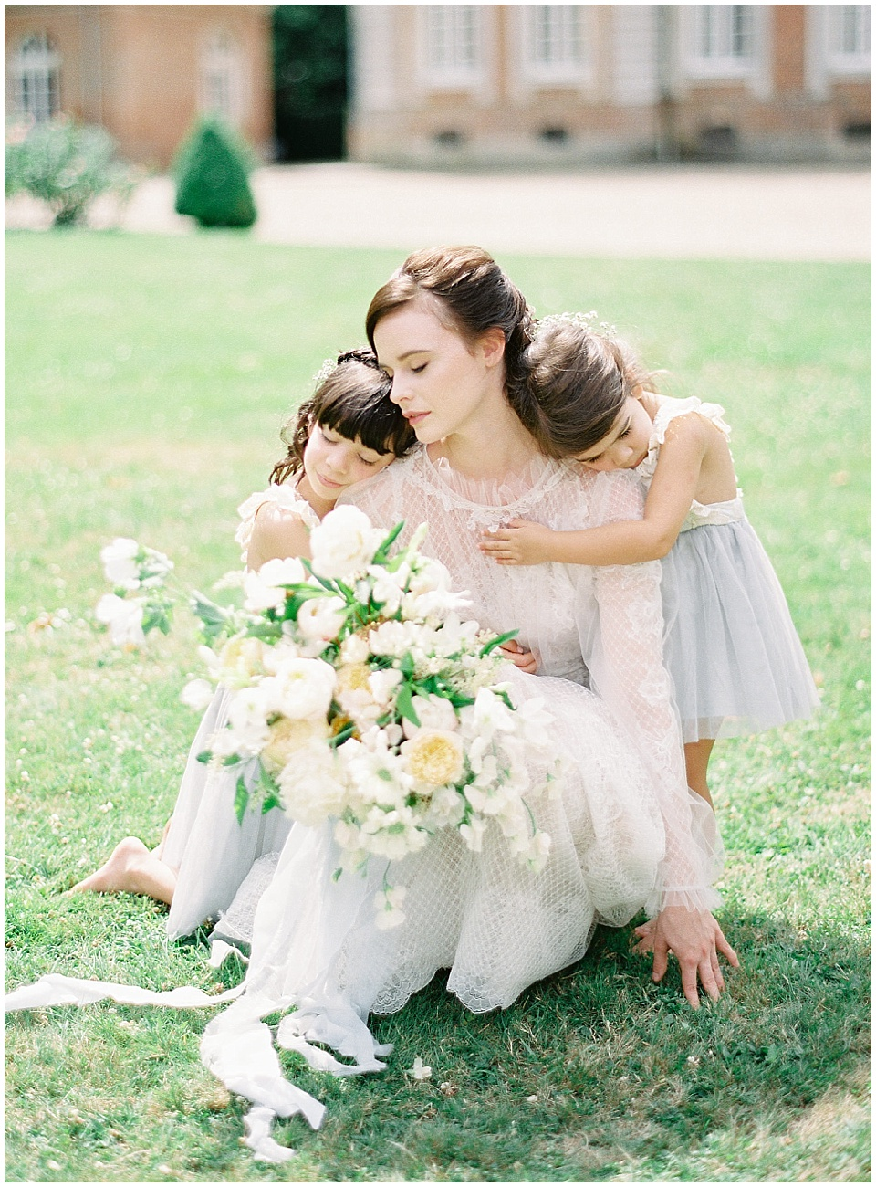 Light blue flower girl dress | Bows and Arrows florals | Bridal Bouquet | White green pale orange blush bridal bouquet | Yolan Cris wedding gown | French Wedding Inspiration | France Wedding | Destination Film Photographer | Paris Wedding | Fine Art Film Photographer | Chateau De Carsix | Whiskers and Willow Photography