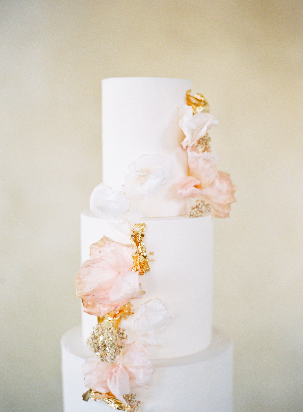 Modern white wedding cake with blush wafer paper flowers by Hey There Cupcake | Luxury wedding | Hidden Castle | Rancho Santa Fe | Estate Events with Venuelust | neutral wedding | European Wedding Inspiration | French wedding | France wedding photographer | Southern California film photographer | San Diego wedding photographer | Whiskers and Willow Photography
