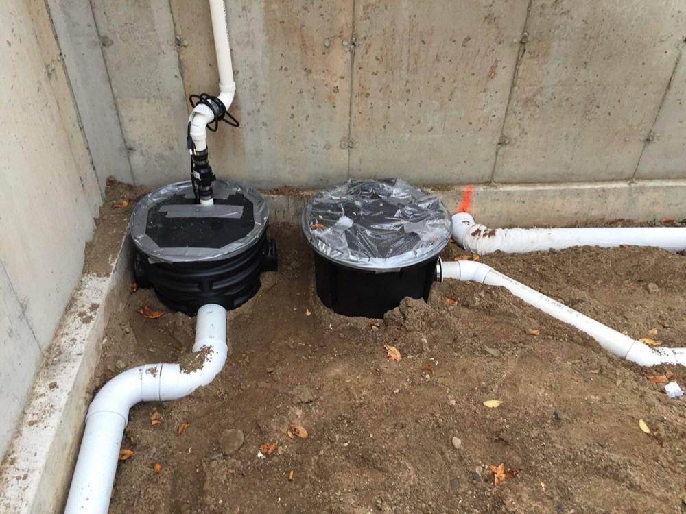 7451 Olympic Basement underground plumbing.jpg