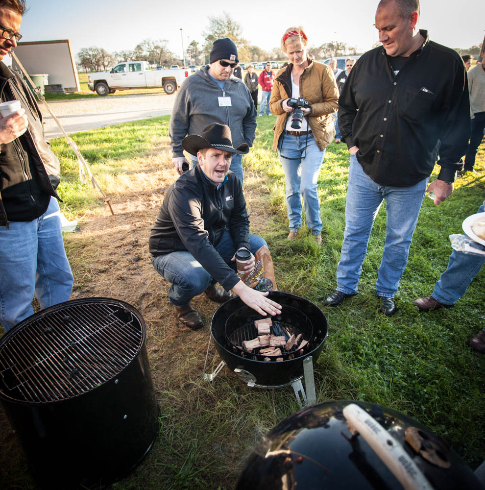 Kevin Kolman discussing the proper way to build a fire in the Weber cooker