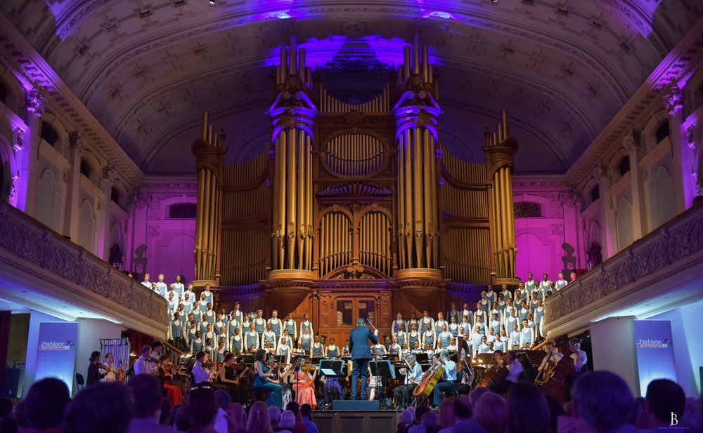 The KZN Philharmonic Orchestra on stage in the PMB City Hall, with the Brindly & Foster organ ( 1901) dominating visually.