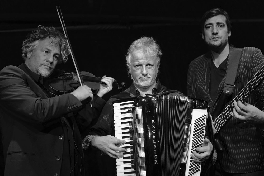 WORLD CAFE Petrus de Beer (violin), Schalk Joubert (bass) & Stanislav Angelov (accordion) play a new version of Vivaldi's FOUR SEASONS Sunday 28 October at Cafe Bon Bon.