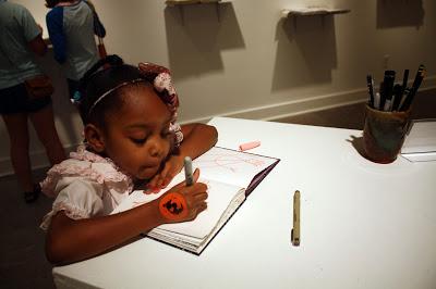 girl drawing in interactive sketchbook at Watkins College