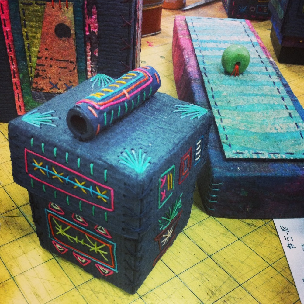 Handmade paper boxes by Claudia Lee.