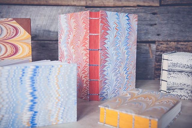 Today is the last day to sign up for my Secret Belgian Binding and Coptic Binding class at @watkinscommunityeducation. In this four-week class that meets on Wednesday evenings in February, you'll learn how to make two different styles of handbound books with distinctive stitching patterns. The Coptic binding is pictured here, and it's sewn with multiple needles to create the lovely multi-colored binding. ⠀⠀⠀⠀⠀⠀⠀⠀⠀ . . . . . #watkinscollege #watkinscommunityeducation #nashville #nashvilletn #madeintennessee #handmadeinnashville #nashvilleartist #nashvillearts #bookarts #bookartist #paperarts #handmadebook #bookbinder #bookbinding #booklover #book #bookaddict #bookworm #handmadejournal #journal #bookstagram #bookish #artclass #bookbindingclass #teachingartist #communityeducation #marbledpaper #papermarbling #copticbinding #carveouttimeforart