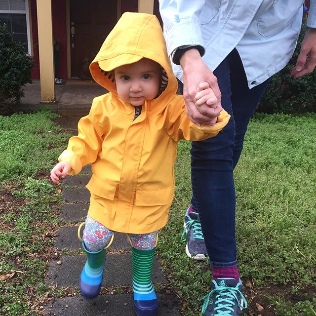 Best thing about a rainy day? Seeing this cutie in her raincoat and boots, of course!