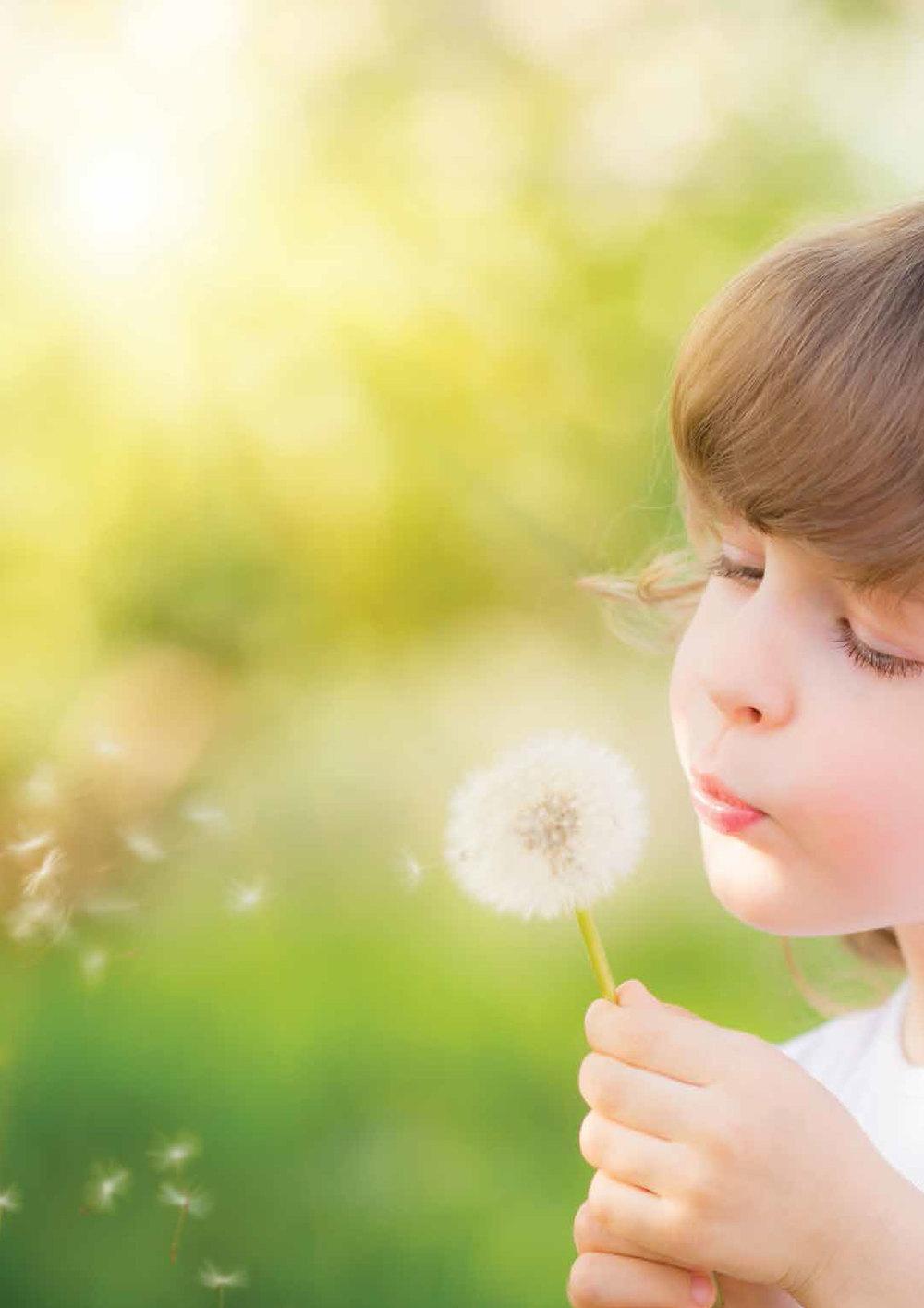 girl blowing flower-01.jpg
