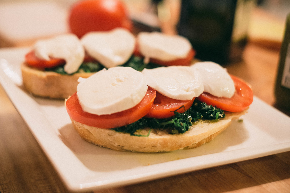 Tomato, kale and mozzarella sandwich with pesto before hitting the panini grill