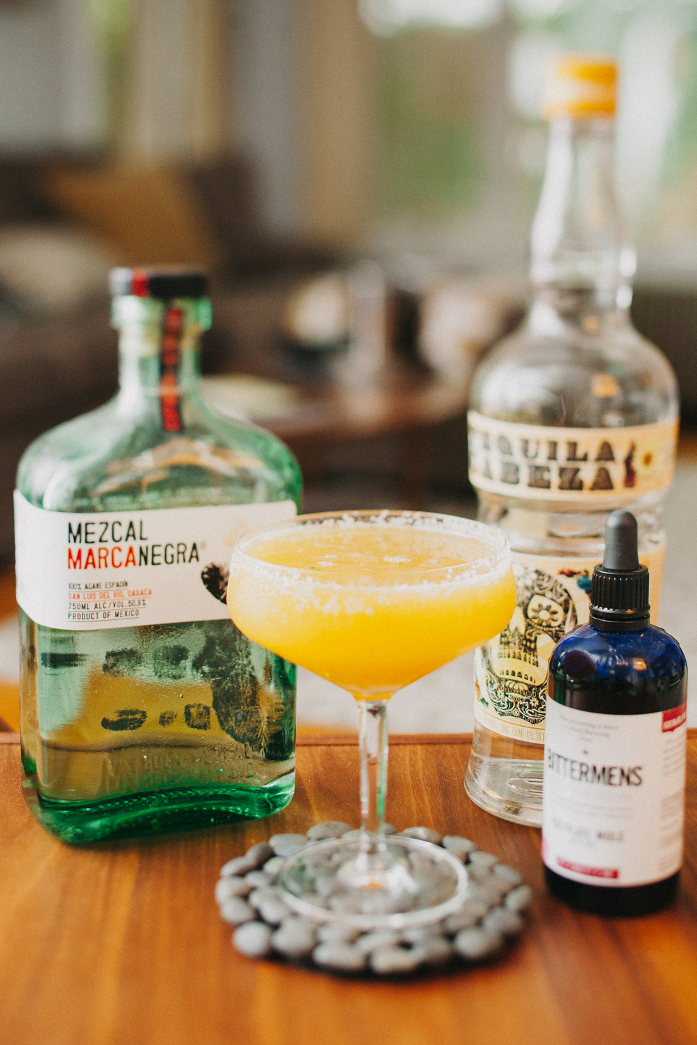 Peach margarita with mezcal and hellfire bitters