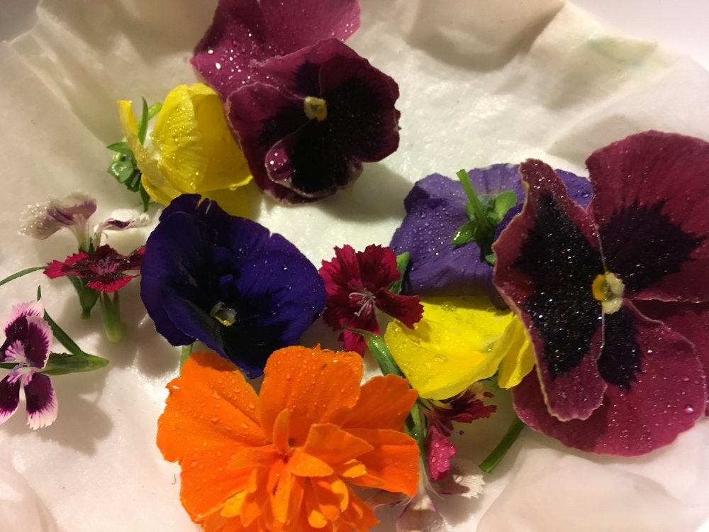 Dianthus, pansies, and marigolds, all delicious, edible and going in with my asparagus for dinner!