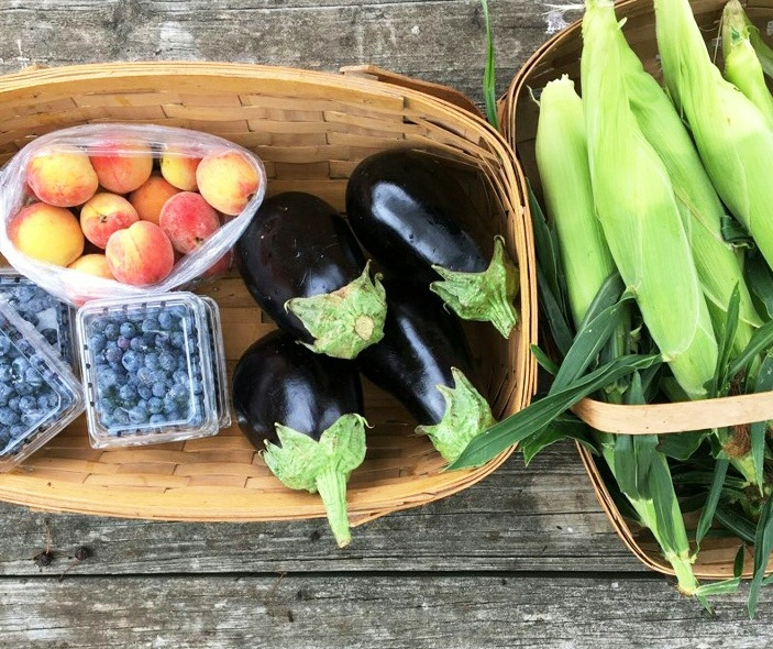 A FULL share from August 2019. (4 pints blueberries, 2 quarts peaches, 8 ears corns, 4 eggplant)