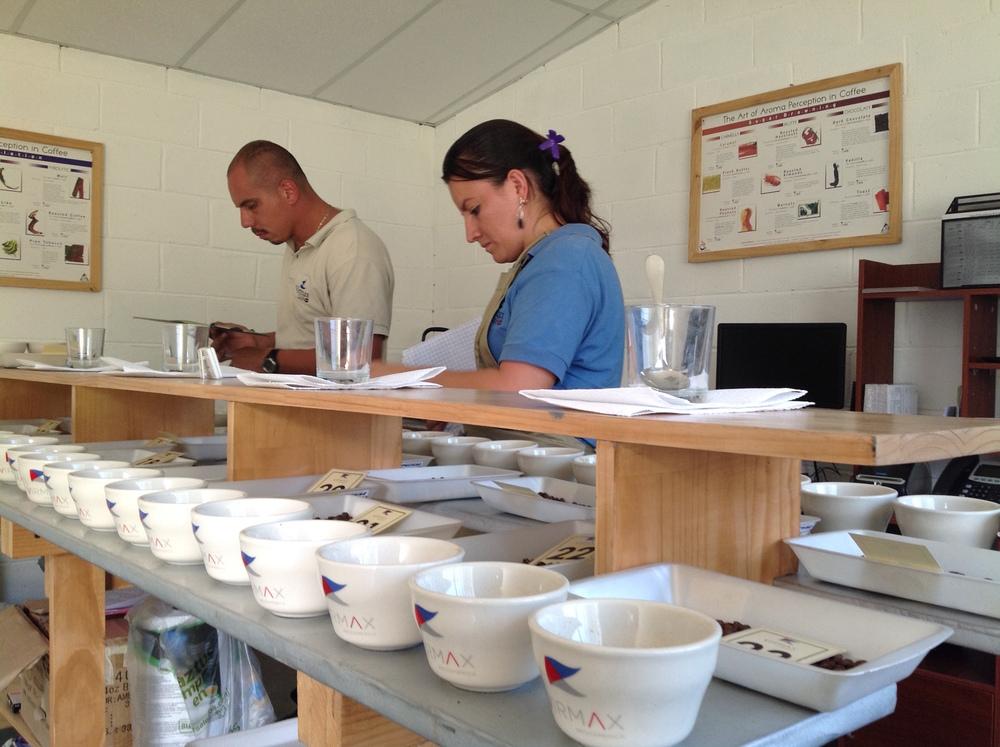 Hugo Lopez and Roxana Vargas in the cupping lab at Beneficio Montecristo