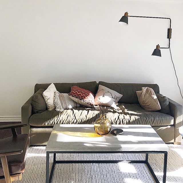 Finalizing with little details. This sofa is a dream. The concrete table was custom built by the General Contractor and crew. They constantly impress me.