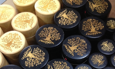 Lazer engraved painted wooden lids.