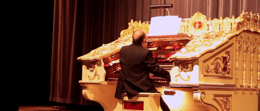 Roger Leir plays an organ shortly before his death.