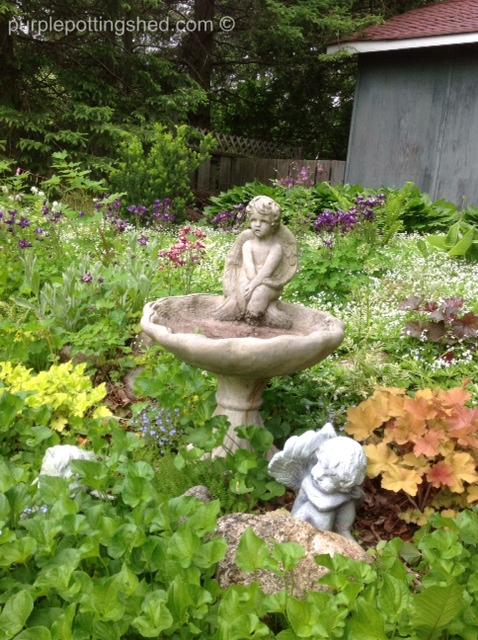 Birdbath in spring garden.jpg