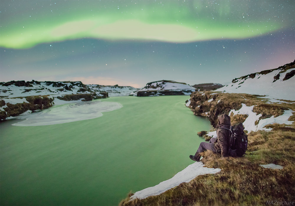 Witnessing the northern lights turn the wind-swept water of Lake Myvatn completely green. [Iceland]