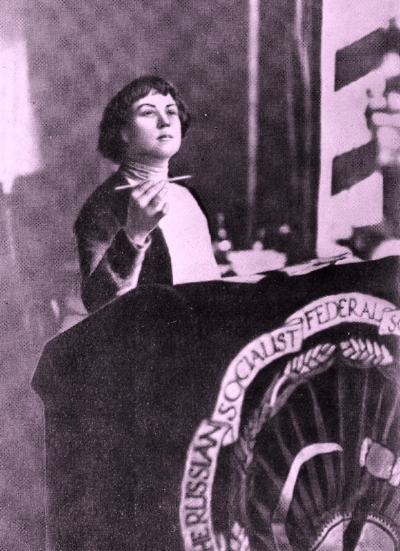 Alexandra Kollontai at the Second International Conference of Communist Women, Moscow, 1921. Image in the public domain, colour manipulated by Rachel Pearce