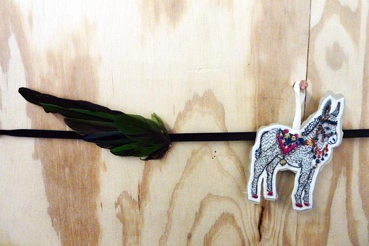 Vestige of the beginning, a milliner wing.