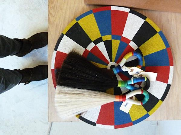 Dart board with horse hair tassels.