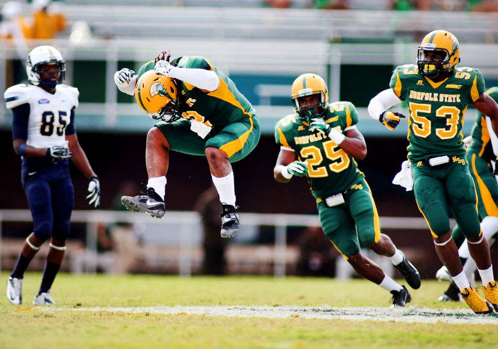 Norfolk State's Mike Privott jumps in the air to celebrate after sacking Charleston Southern quarterback Malcolm Dixon, Saturday, September 21, 2013 at Dick Price Stadium in Norfolk. Charleston Southern won 20-12.