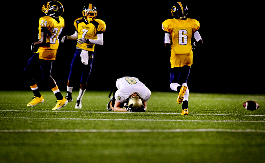 Cox's Carter Kovalcheck, in white, reacts after dropping a pass intended for him late in the second quarter as Ocean Lakes defenders (L to R) Corey Taylor, Treavonn (cq) Brandon and Devontae Colona, look on, Friday, September 9, 2011 at the Sportsplex in Virginia Beach.