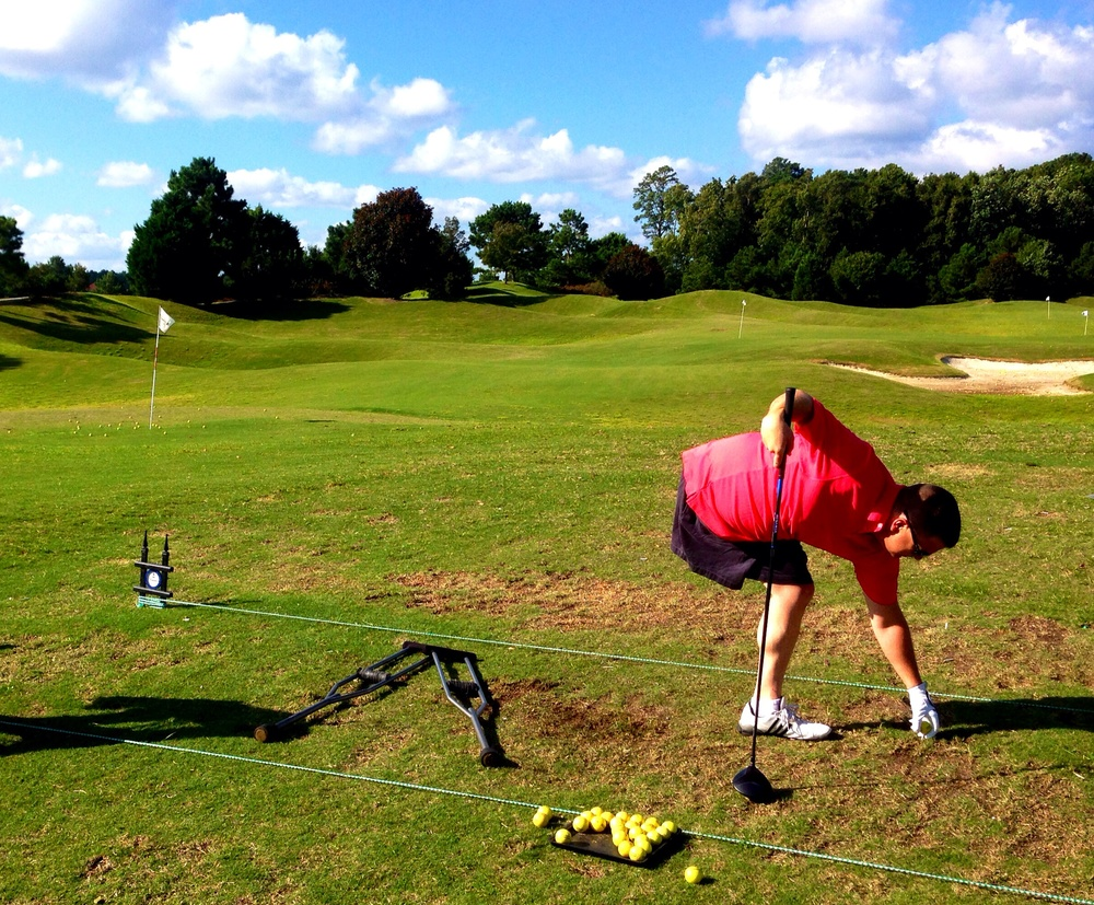 """Roger Altby, an Armyveteran andamputee warms up on the driving range. Altby lost his leg after an IED explosion in Iraq and now golfs """"because it's peaceful""""."""
