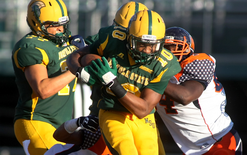 Norfolk State's Brendon Riddick barrels through Morgan State defenders for a first down during NSU's 15-14 win, Saturday, Sept. 27, 2014 at Dick Price Stadium in Norfolk.        (Jason Hirschfeld | For The Virginian-Pilot)
