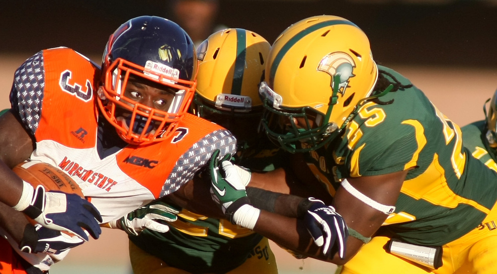 Norfolk State's Keenan Lambert, right, and Brandon Walker wrap up Morgan State's Herb Walker, Jr for a loss of yardage during NSU's 15-14 win, Saturday, Sept. 27, 2014 at Dick Price Stadium in Norfolk.   (Jason Hirschfeld | For The Virginian-Pilot)