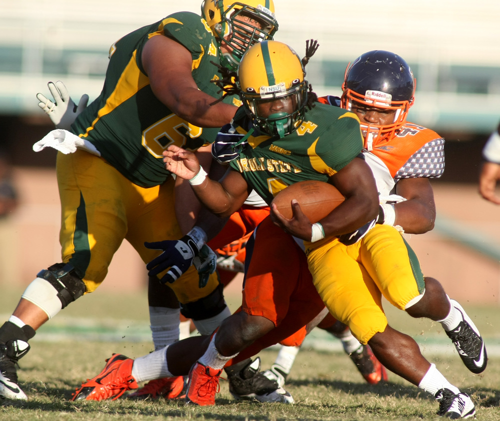 Norfolk State's Eric Pittman avoids Morgan State's Greg Gibson for a gain during NSU's 15-14 win, Saturday, Sept. 27, 2014 at Dick Price Stadium in Norfolk.  (Jason Hirschfeld | For The Virginian-Pilot)