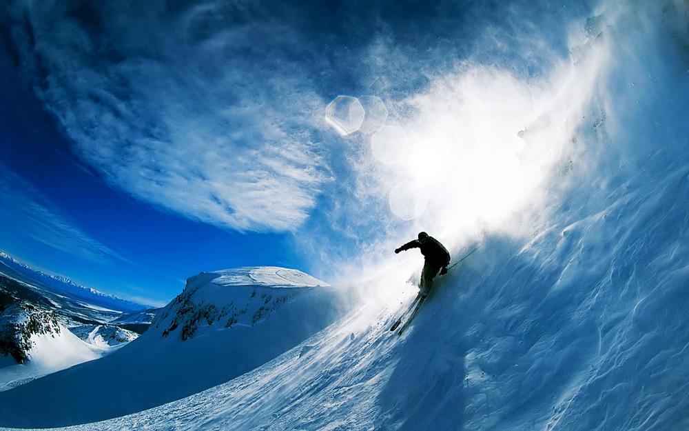 Trevor Rosenberg snowboards down a hill in Provo, UT.