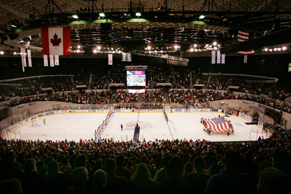 Fans stand for the national anthem before the start of the Admirals' home opener against Hershey, Saturday, Oct. 11, 2014 at Scope in Norfolk.    (Jason Hirschfeld | For The Virginian-Pilot)