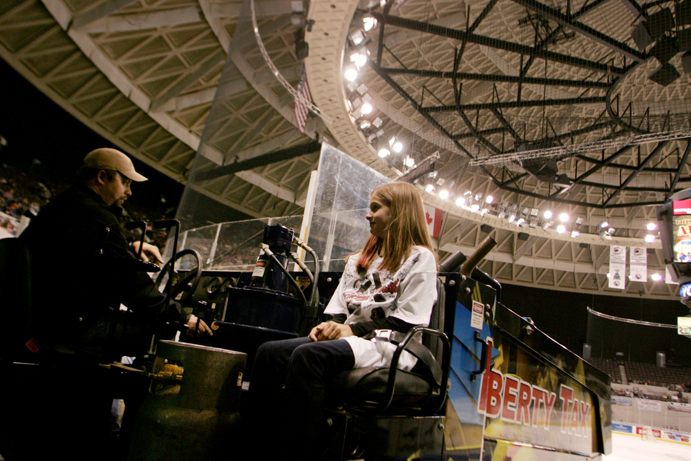 Elissa Burks, 10, gets a ride on the zamboni for her birthday before the start of the Admirals' home opener against Hershey, Saturday, Oct. 11, 2014 at Scope in Norfolk.  (Jason Hirschfeld | For The Virginian-Pilot)