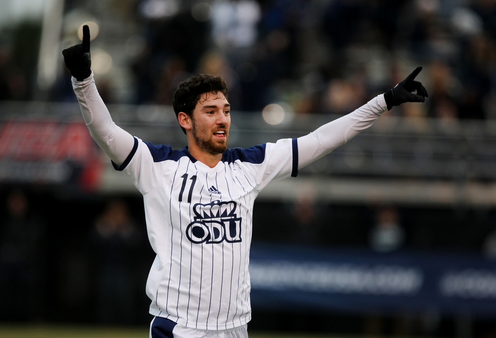 Old Dominion's Geoffrey Hill celebrates after scoring a goal during second half action of ODU's 2-1 win over University of South Carolina to claim the Conference USA Men's Soccer Final, Sunday, Nov. 16, 2014 at ODU in Norfolk. (Jason Hirschfeld | For The Virginian-Pilot)