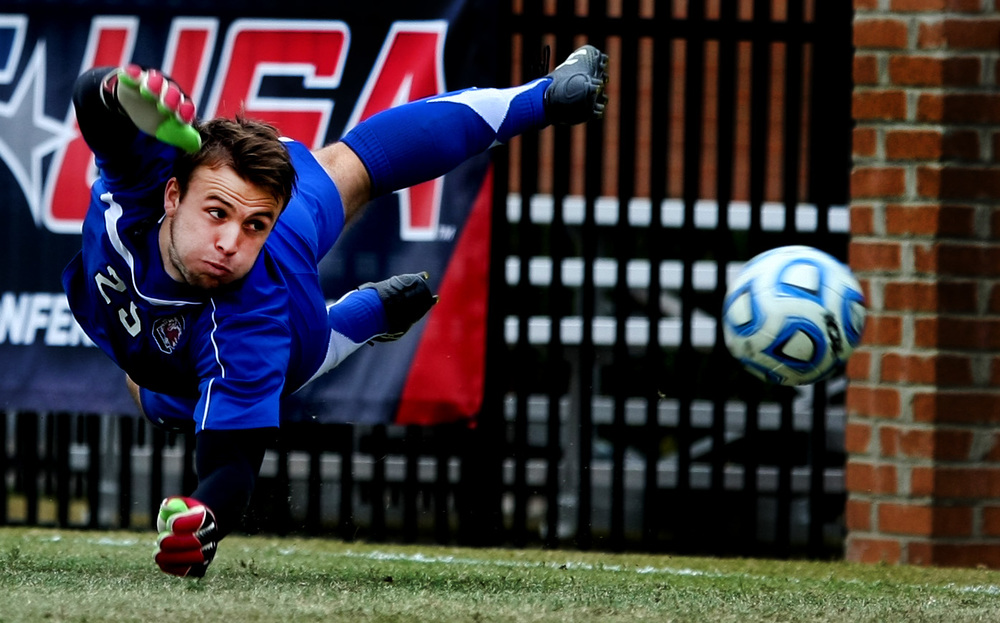 University of South Carolina goalkeepe rMarco Velez can't stop a shot by Old Dominion's Sidney Rivera during the first half of ODU's 2-1 win over University of South Carolina to claim the Conference USA Men's Soccer Final, Sunday, Nov. 16, 2014 at ODU in Norfolk.