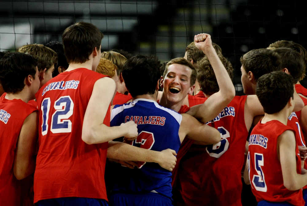Princess Anne's Noah Banasiewicz celebrates with teammates after winning the Group 5A boys volleyball state championship over Deep Run, Friday, Nov. 21, 2014 at the Siegel Center in Richmond.  (Jason Hirschfeld | For The Virginian-Pilot)