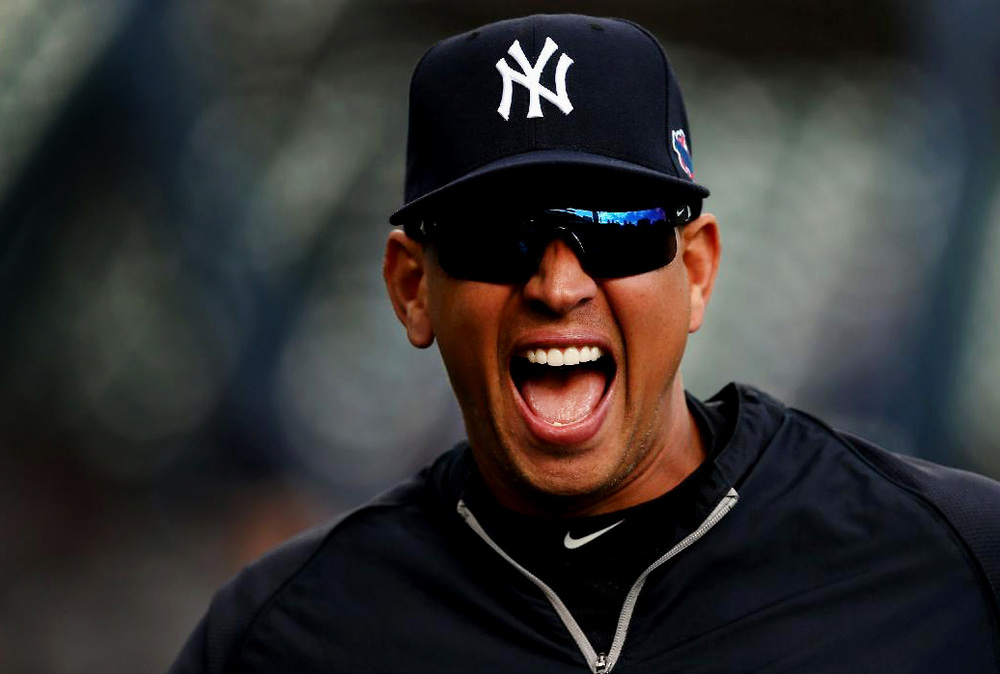 New York Yankees designated hitter Alex Rodriguez laughs with teammates after a batting cage session at George M. Steinbrenner Field in Tampa, FL.