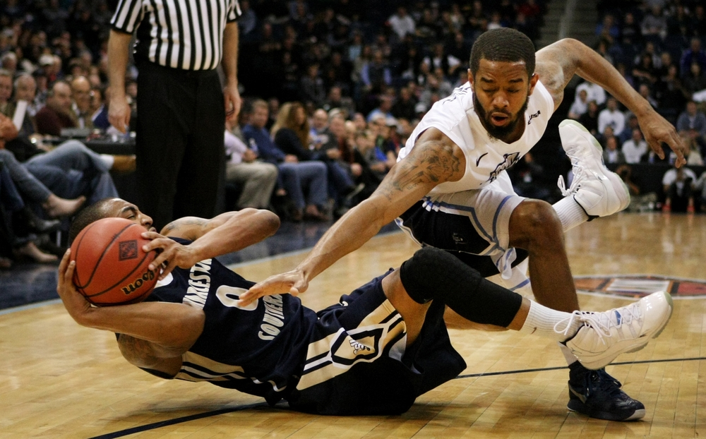 Old Dominion's Aaron Bacote, right, and Charleston Southern's Robert Wilson battle for a loose ball during the first half of an NCAA college basketball game in the National Invitational Tournament, Wednesday, March 23, 2015 in Norfolk, Va.  (AP Photo/Jason Hirschfeld)