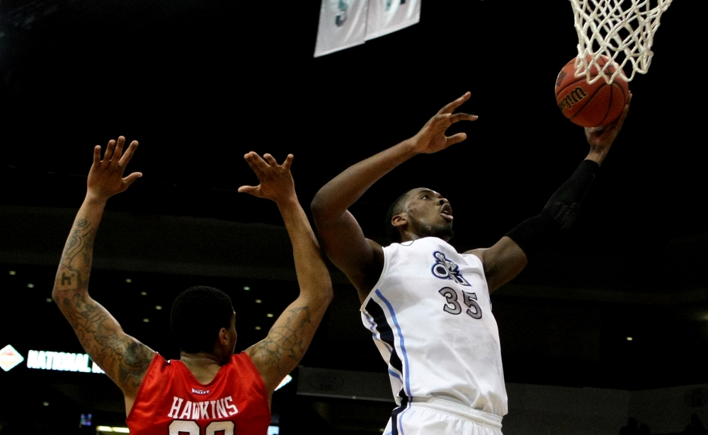 Old Dominion's Jonathan Arledge drives past Illinois State's Deontae Hawkins (23) during the first half of an NCAA college basketball game in the National Invitational Tournament, Monday, March 23, 2015 in Norfolk, Va. (AP Photo/Jason Hirschfeld)