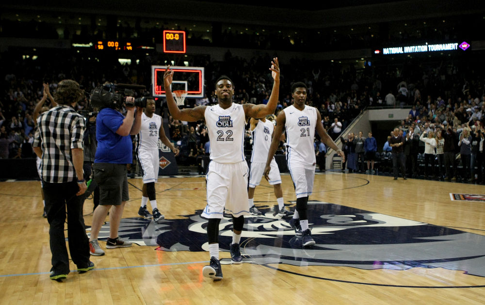Old Dominion's Ambrose Mosley (22) celebrates after their 50-49 win over Illinois State in an NCAA college basketball game  in the National Invitational Tournament, Monday, March 23, 2015 in Norfolk, Va. (AP Photo/Jason Hirschfeld)